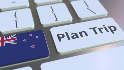 PLAN TRIP text and flag of New Zealand on the computer keyboard, travel related Footage