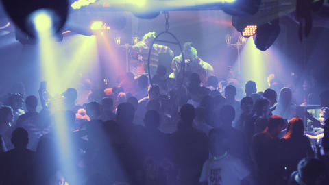 Night party, night rave. Young people having fun, taking drugs. The spotlights Footage