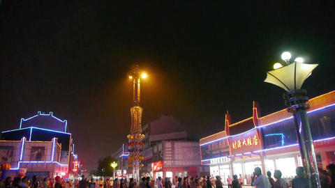 Dancing Chinese People Crowd In The Square At Night.Flashing Neon Commercial Street stock footage
