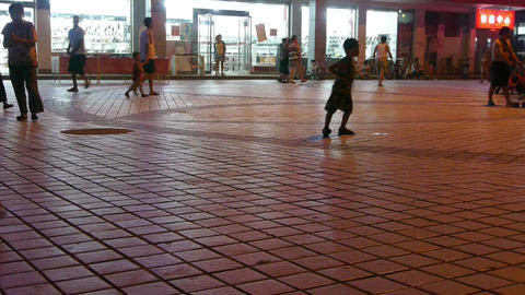 The flashing neon Commercial Street.Children playing in... Stock Video Footage