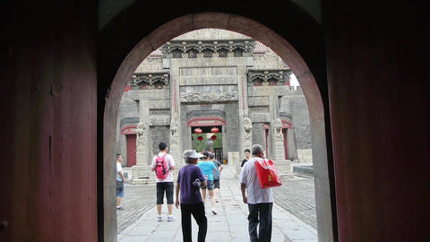 Through gate to see sculpture of ancient arch.China visitors & tourists Footage