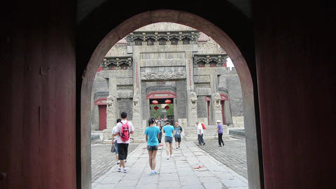 Through gate to see sculpture of ancient arch.China... Stock Video Footage