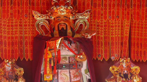 Chinese God sculpture of wealth,Red sign make wish Footage