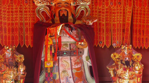 Chinese God sculpture of wealth,Red sign make wish Stock Video Footage