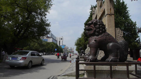 Bronze metal stone lion unicorn & China stone arch in front of ancient city  Footage