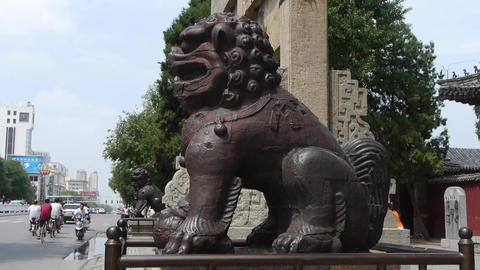 Bronze metal stone lion unicorn & China stone arch in... Stock Video Footage