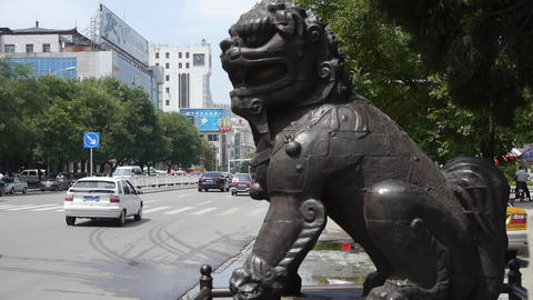 Bronze metal stone lion unicorn.sculpture statue,stone-carvings.Urban town busy  Footage