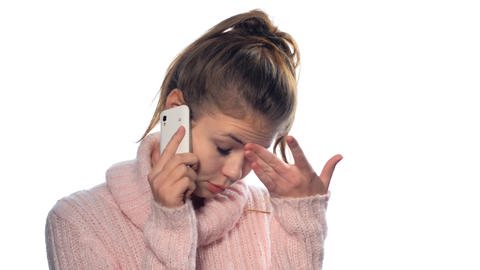 Beautiful blonde girl with long hair on the phone Stock Video Footage