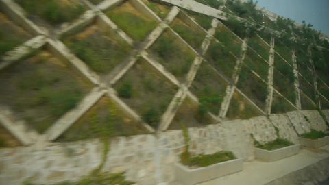 Speeding train travel,scenery outside window.Villages tree & Guardrail Footage
