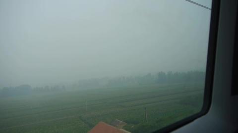 Speeding train travel,scenery outside window.Villages plains tree Footage