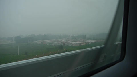 Speeding train travel,scenery outside window.Villages plains tree farmland Footage