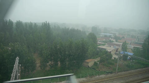 Speeding train travel,scenery outside window.Villages plains tree farmland.high- Footage