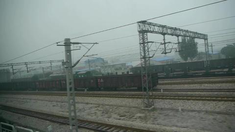 Speeding train travel,scenery outside window.Villages plains tree farmland.train Footage