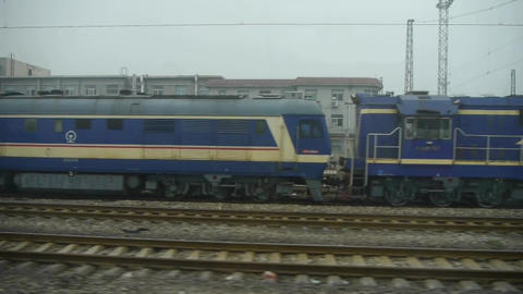 Speeding train travel,scenery outside window.train-station locomotives Footage