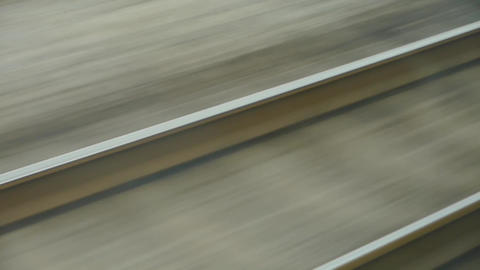 Speeding train travel,scenery outside window.train-station rail Footage