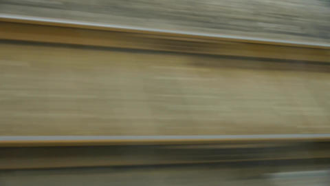Speeding train travel,scenery outside window.train-station rail Footage