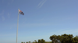 Australian Flag Flying Against Blue Sky Stock Video Footage