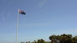 Australian Flag Flying Against Blue Sky Footage