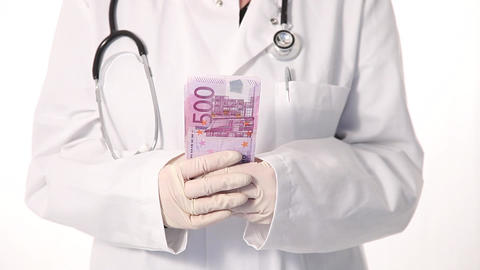Torso of a doctor counting cash Stock Video Footage