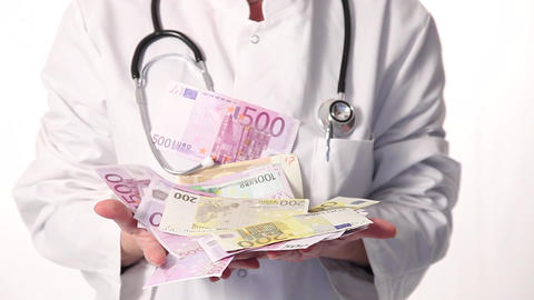 Doctor catching hands full of money Stock Video Footage