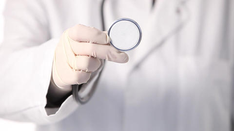 Doctor holding a stethoscope disc Stock Video Footage
