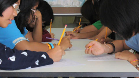 Asian Students Practising Writing English Stock Video Footage