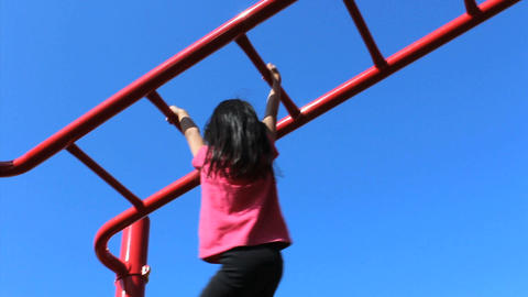 Asian Girl On Monkey Bars At Playground Stock Video Footage