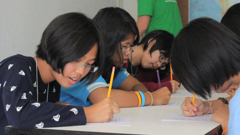 Asian Students Writing English Exam Stock Video Footage