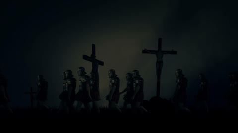 Roman Soldiers Passing By Crucified Victims Under a Storm Footage