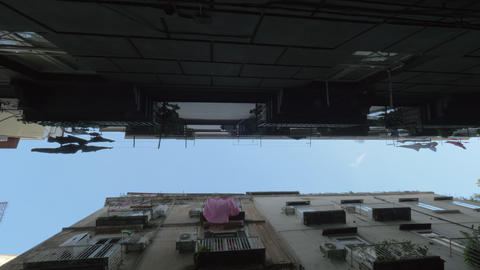 A bottom view of a narrow street Footage