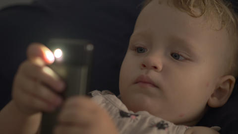 A baby with a smartphone Archivo