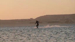 Slow Motion Kiteboarding in Slow Motion at Sunset Live Action