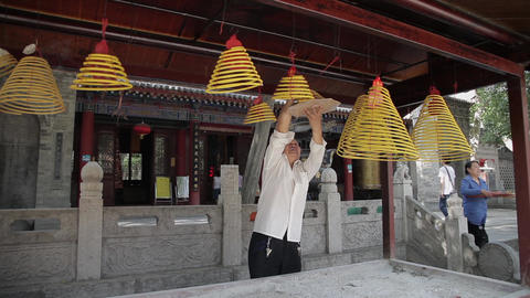 XI'AN, CHINA - MAY 24, 2012: Visitors burn incense and pray in Daxingshan Temple Footage
