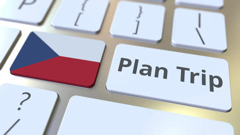 PLAN TRIP text and flag of the Czech Republic on the computer keyboard, travel Footage