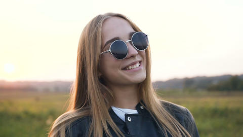 Wonderful young woman smiling to the camera Live Action