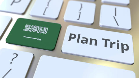 PLAN TRIP text and flag of Saudi Arabia on the computer keyboard, travel related Footage