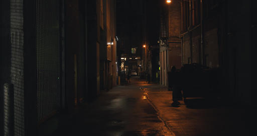 Establishing shot of a dark alleyway at night Footage