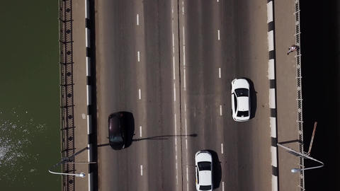 Drone's Eye View - 4K road city top view of urban traffic jam on a car bridge Footage