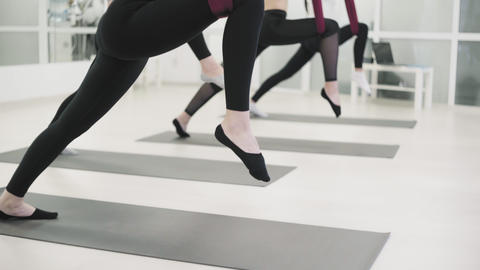 Young women is practicing aero yoga in sports club. women stretches legs Footage