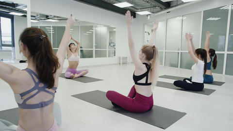 Yoga Practice Exercise Class Concept. Trainer helps student with exercise Live Action