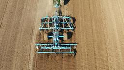 Tractor with disc harrows on the farmland Archivo