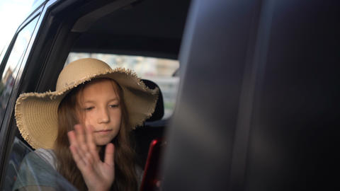 girl with straw hat sharing social media in a smart phone. road trip concept Live Action