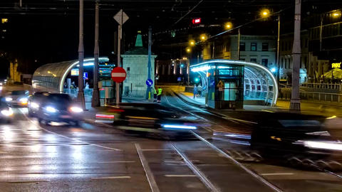 The night in Warsaw. High, city lights come to light. On a wide road, cars Footage