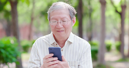 Older man use cellphone Live Action