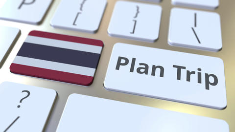 PLAN TRIP text and flag of Thailand on the computer keyboard, travel related 3D Footage