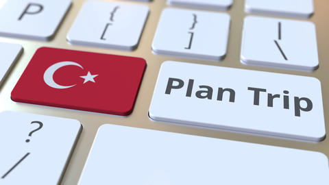 PLAN TRIP text and flag of Turkey on the computer keyboard, travel related 3D Footage