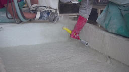 Production of concrete products. Concrete watered.... Stock Video Footage