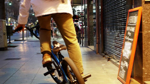 Guys friends cyclists ride along big road full of cars in... Stock Video Footage