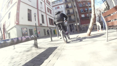 Extreme BMX biker doing different spins and tricks on bike in urban environment Footage