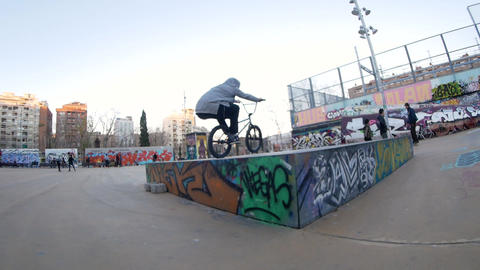 Teenager BMX rider makes different spins and tricks on bike in urban environment Footage